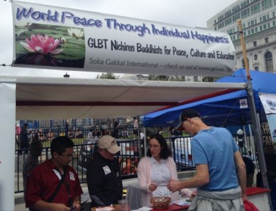 Managing a booth introducing passersby to Nichiren Buddhism during a Pride event in San Francisco [© SGI-USA]
